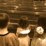 Caden, Carley and Avery in line at Space Mountain